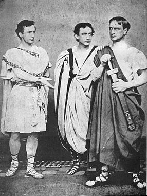 <b>Edwin Booth in Julius Ceasar</b>     	</br>John Wilkes Booth, Edwin Booth, and Junius Brutus Booth Jr. in Julius Caesar</br><br/><b>Source: </b><i>Public Domain. https://en.wikipedia.org/wiki/Edwin_Booth</i>