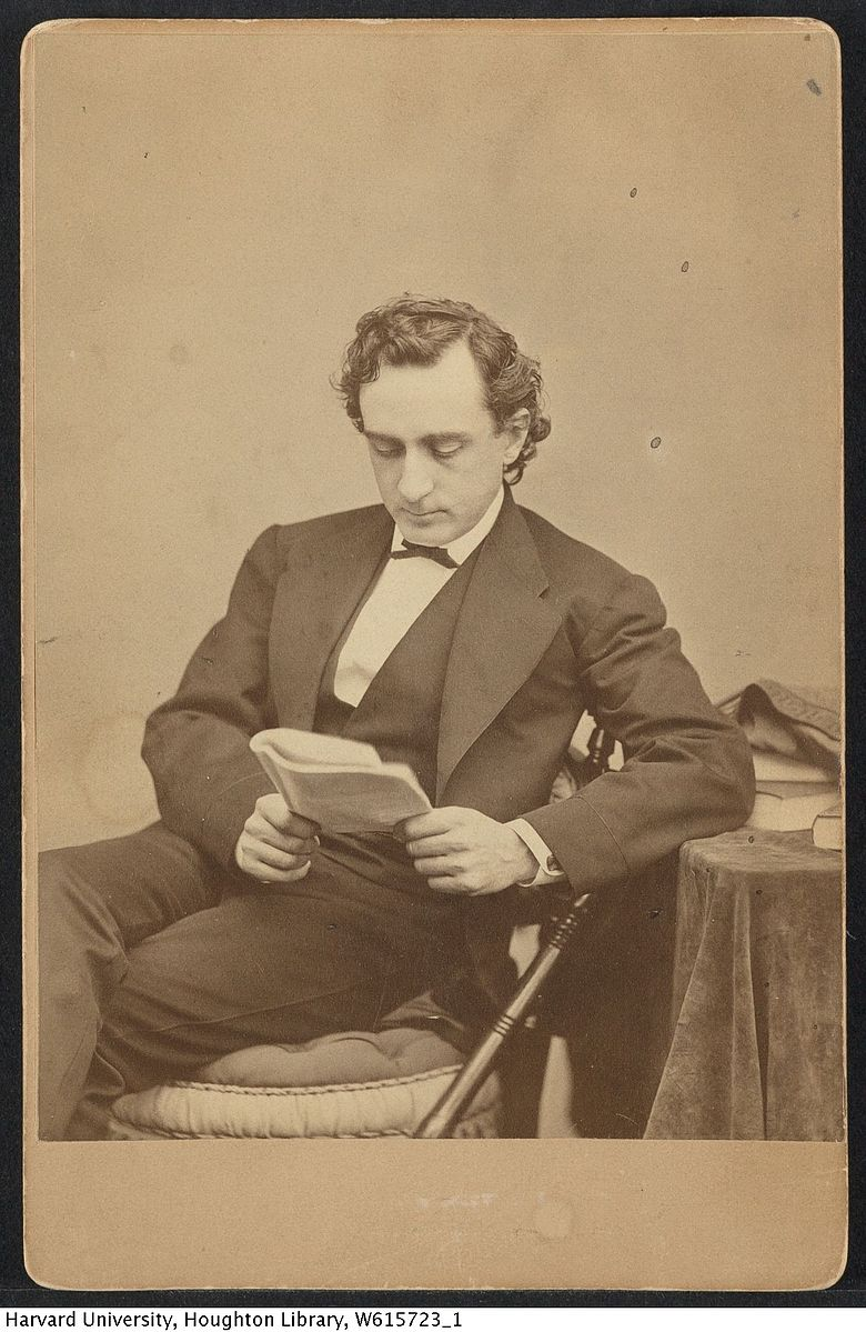 <b>Edwin Booth</b>     	</br>Cabinet card image of American actor Edwin Booth, seated and reading circa 1893.</br><br/><b>Source: </b><i>Public Domain TCS 1.2821, Harvard Theatre Collection, Harvard University, https://commons.wikimedia.org/wiki/File:Harvard_Theatre_Collection_-_Edwin_Booth_TCS_1.2821.jpg</i>